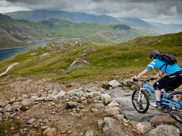 Guided mountain biking down a technical trail in Snowdonia