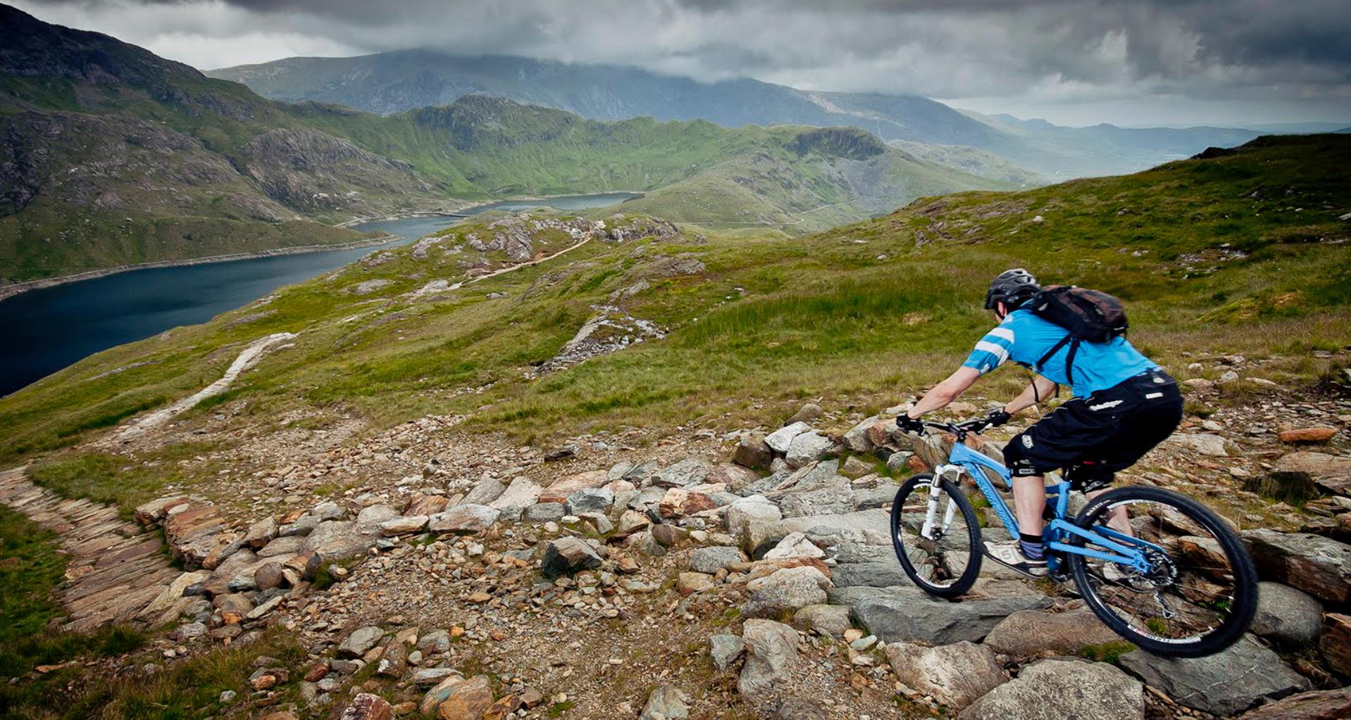 Mountain biker descends technical trail in Snowdonia