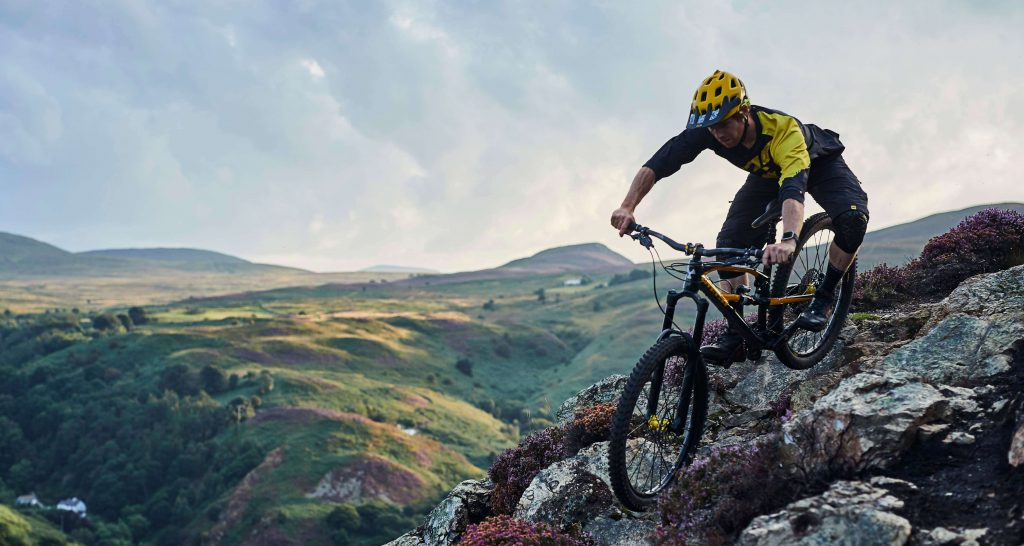 Mountain biker riding rocky trail in Wales on short MTB break