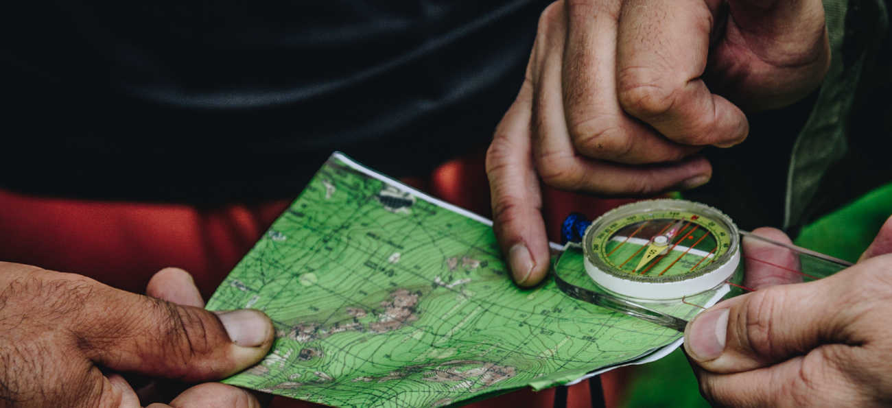 map and compass being used to plot mtb route in snowdonia