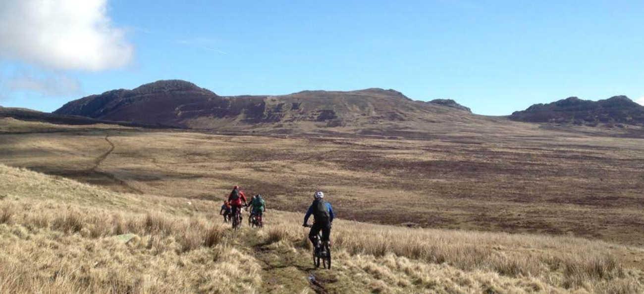 mountain bikers being led through Snowdonia
